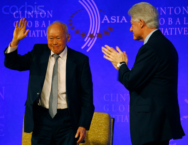 Singapore's Minister Mentor Lee Kuan Yew waves next to former U.S. president Bill Clinton after attending the Clinton Global Initiative Asia Meeting in Hong Kong